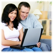 Couple doing a home search on-line